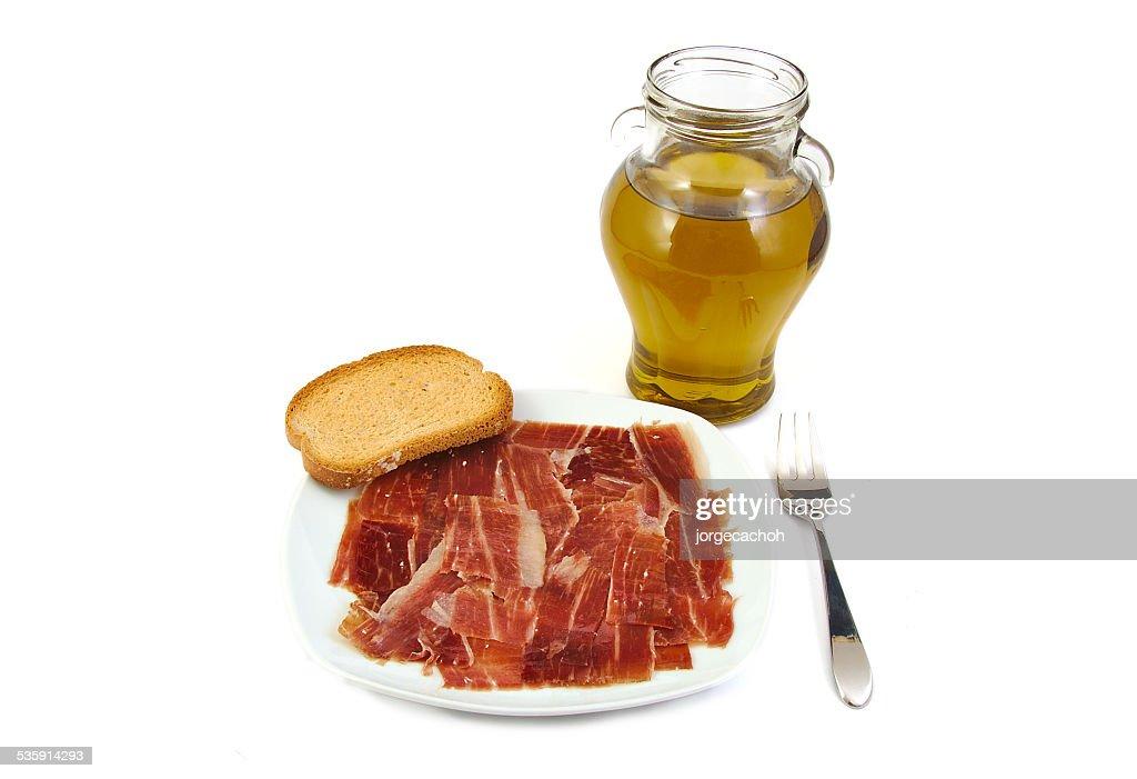 Jamón Serrano, pan y aceite de oliva extra virgen. Jabugo. Mediterráneo, : Foto de stock
