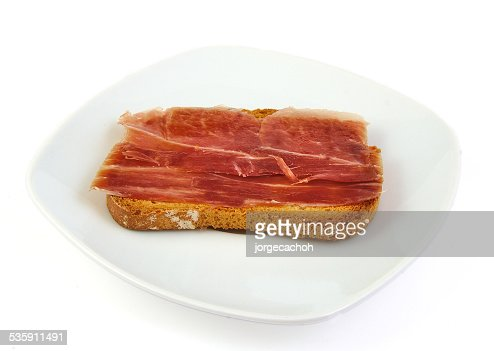 Serrano ham on toasted bread. Jabugo. Spanish tapa : Stock Photo