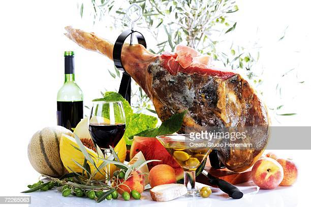 Serrano ham with olives and fruits, close-up
