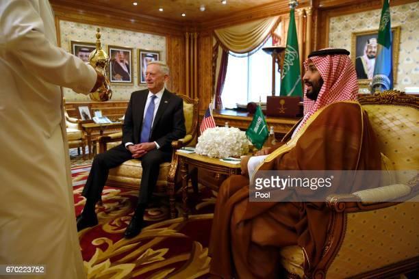 A servant brings tea as Saudi Arabia's Deputy Crown Prince and Defense Minister Mohammed bin Salman welcomes US Defense Secretary James Mattis on...