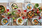 High angle view of served dining table full of healthy food