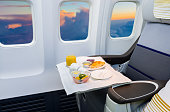 Airplane cabin business class interior and meal