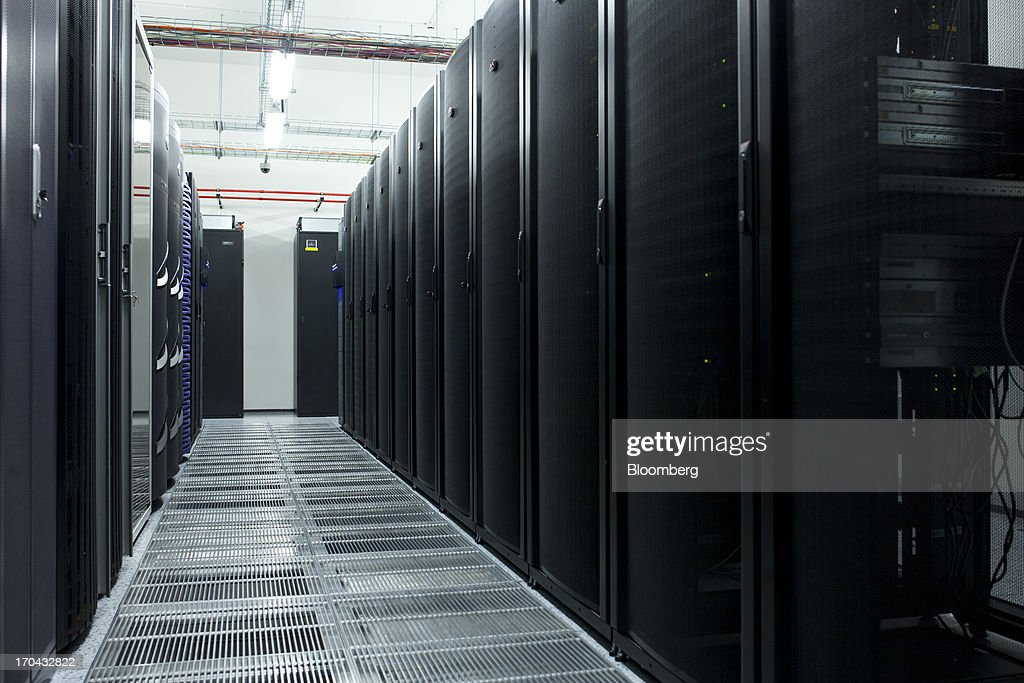 Server cabinets stand in the information technology (IT) centre of Orange Polska, also known as Telekomunikacja Polska SA (TPSA), Poland's national telecommunications company, in Warsaw, Poland, on Wednesday, June 12, 2013. Cable providers are being drawn to Poland, the European Union's biggest eastern economy, because penetration levels are half that of neighboring Germany even as unemployment rises, according to a website presentation by the country's biggest TV network, Cyfrowy Polsat SA. Photographer: Bartek Sadowski/Bloomberg via Getty Images