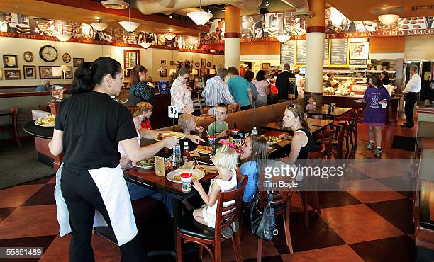 A server delivers food to customers at a Corner Bakery Cafe October 4 2005 in Glenview Illinois Dallasbased Brinker International has agreed to sell...