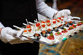 Server holding a tray of appetizers at a banquet