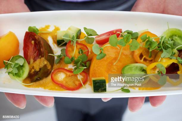 WASHINGTON DC A server holds the Roasted Gazpacho Salad English Cucumber Red and Yellow Tomato Roasted peppers Maui sweet onions and tomato...