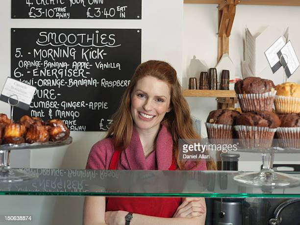 Server smiling behind bakery counter
