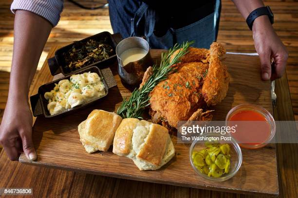 HARBOR MD Server Stacy James holds a board with the Whole Bird Royale at Marcus restaurant at MGM Grand Casino photographed in National Harbor MD