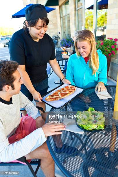 Server Waitress Serving Young Couple at Casual Outdoor Fast Food Restaurant
