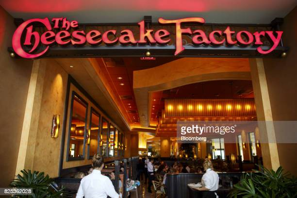 Servers attend to customers as they dine at a Cheesecake Factory Inc restaurant in the Canoga Park neighborhood of Los Angeles California US on...