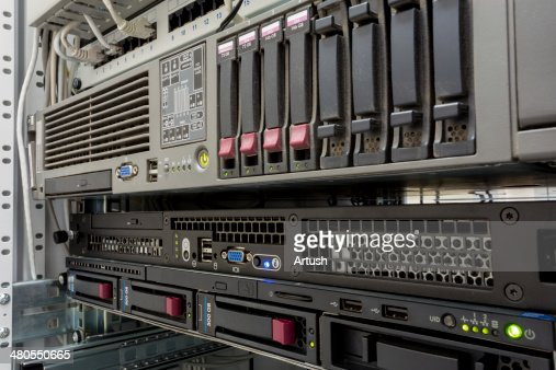 servers stack with hard drives in a datacenter : Stock Photo