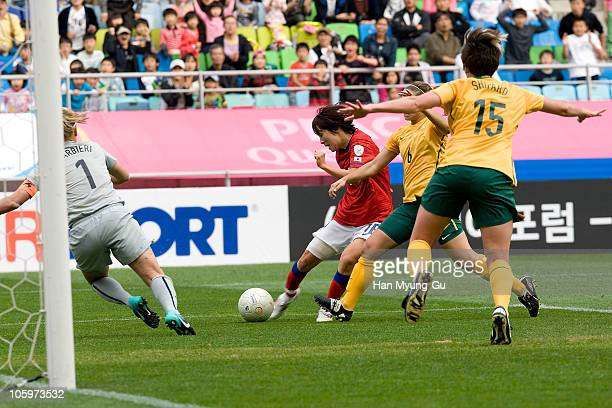 Servet Uzunlar of Australia and Park HeeYoung of South Korea compete for the ball during the Peace Queen Cup Final match between Australia and South...