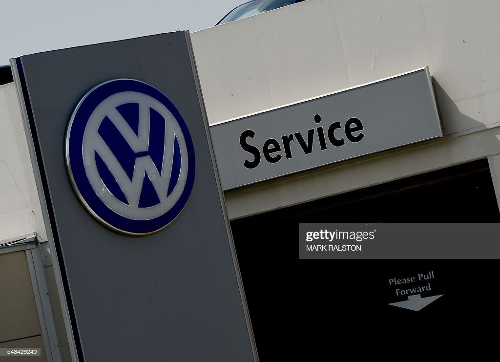A service area at a Volkswagen dealership in Los Angeles, California on June 28, 2016. Volkswagen has agreed to pay out $14.7 billion in a settlement with US authorities and car owners over its emissions-cheating diesel-powered cars. The settlement filed in federal court calls for the German auto giant to either buy back or fix the cars that tricked pollution tests, and to pay each owner up to $10,000 in cash. / AFP / Mark Ralston