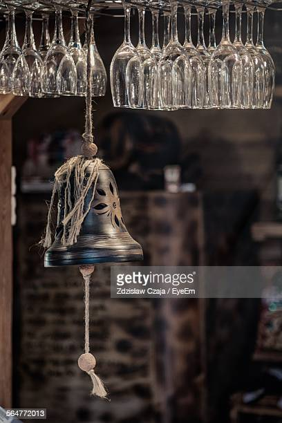 Service Bell Against Wineglass At Bar