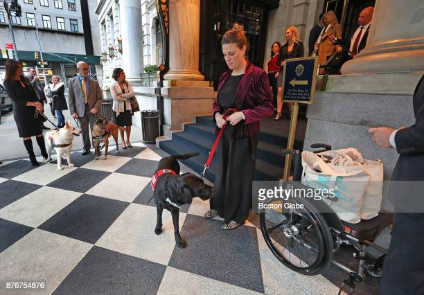 Service dog Rescue and his owner Jessica Kensky wait outside the Plaza Hotel for the limo to take them to the awards ceremony where Rescue is being...