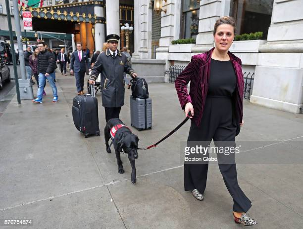 Service dog Rescue walks from the Plaza Hotel to his limo with his owner Jessica Kensky as they check out of the Plaza Hotel in New York City on Nov...