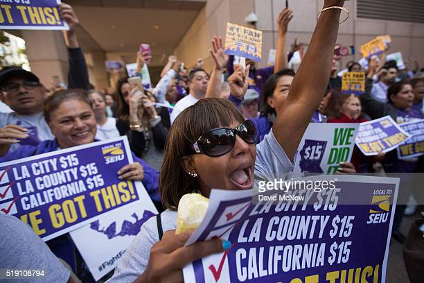 Service Employees International Union members celebrate after California Governor Jerry Brown signed landmark legislation SB 3 into law on April 4...
