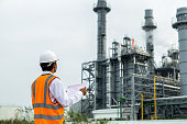 Service engineer is working at gas turbine  electric power plant