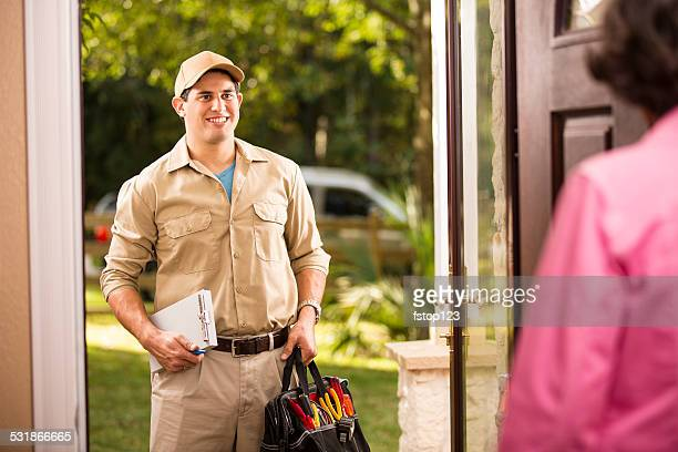 Service Industry: Latin descent repairman at customer's front door.