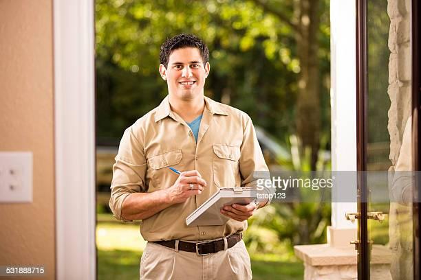 Service Industry: Latin descent repairman at customer's front door.