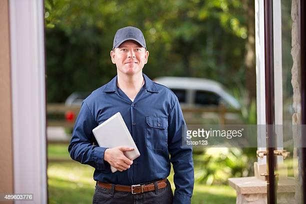 Service Industry: Repairman at customer's front door. Digital tablet.