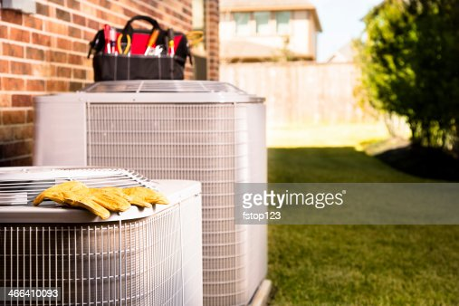 Service Industry:  Work tools on air conditioners. Outside residential home.