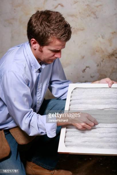 Service Man Changing Furnace Air Filter