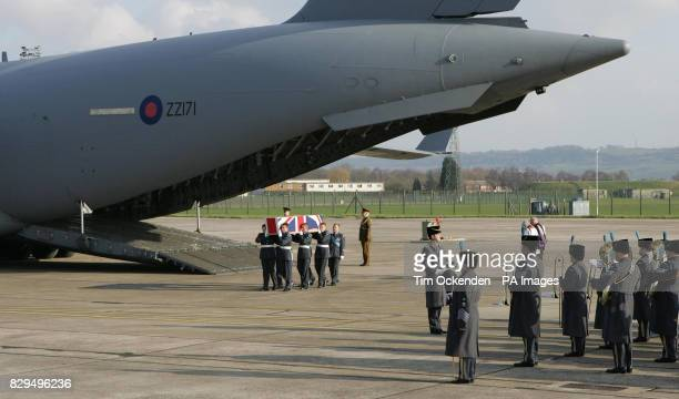 Service personnel carry the coffin of Chief Technician Richard Brown as it is returned to the UK He was one of ten servicemen killed when the C130...