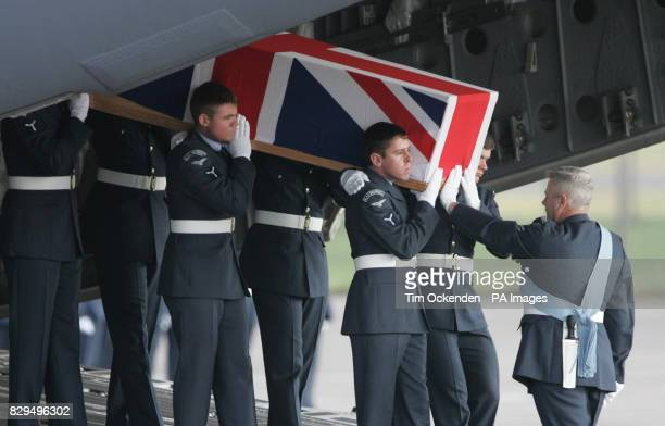 Service personnel carry the coffin of Flight Lieutenant David Stead as it is returned to the UK He was one of ten servicemen killed when the C130...