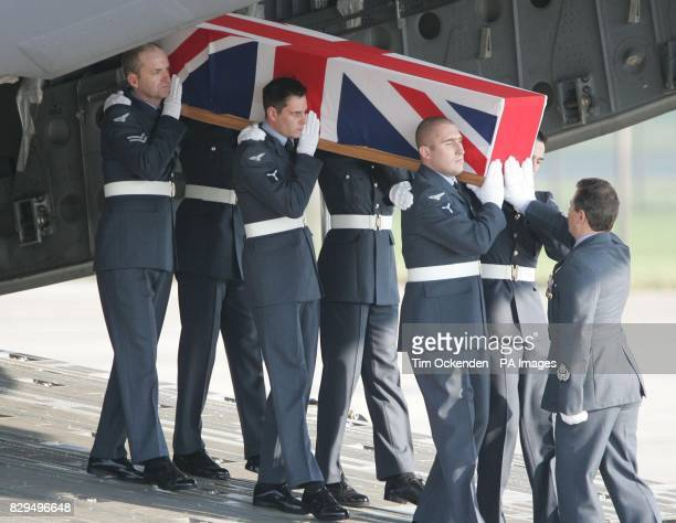 Service personnel carry the coffin of Flight Sergeant Mark Gibson as it is returned to the UK He was one of ten servicemen killed when the C130...