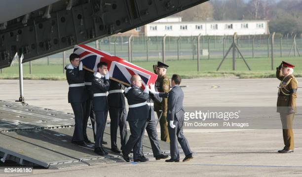 Service personnel carry the coffin of Master Engineer Gary Nicholson as it is returned to the UK He was one of ten servicemen killed when the C130...