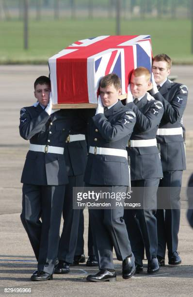 Service personnel carry the coffin of Sgt Robert O'Connor as it is returned to the UK He was one of ten servicemen killed when the C130 Hercules...