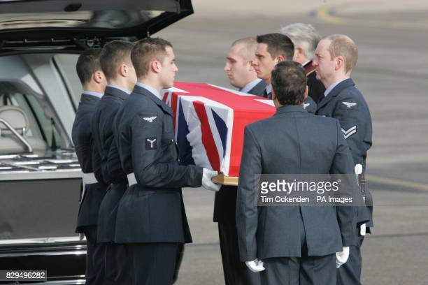 Service personnel carry the coffin of Squadron Leader Patrick Marshall as it is returned to the UK He was one of ten servicemen killed when the C130...