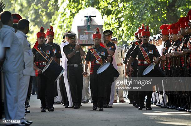 Service personnel carry the mortal remains of former President APJ Abdul Kalam from his New Delhi residence to board a special aircraft to Rameswaram...