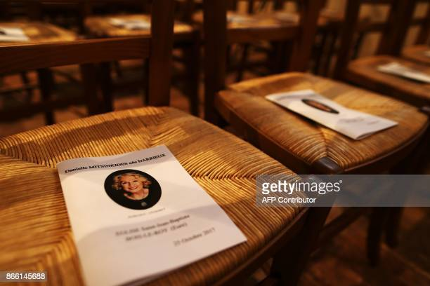 Service sheets are seen on chairs ahead of the arrival of mourners attending the funeral service of the French actress Danielle Darrieux in BoisleRoi...