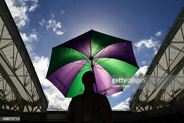 A service steward is seen on Centre Court on day six of the Wimbledon Lawn Tennis Championships at the All England Lawn Tennis and Croquet Club on...