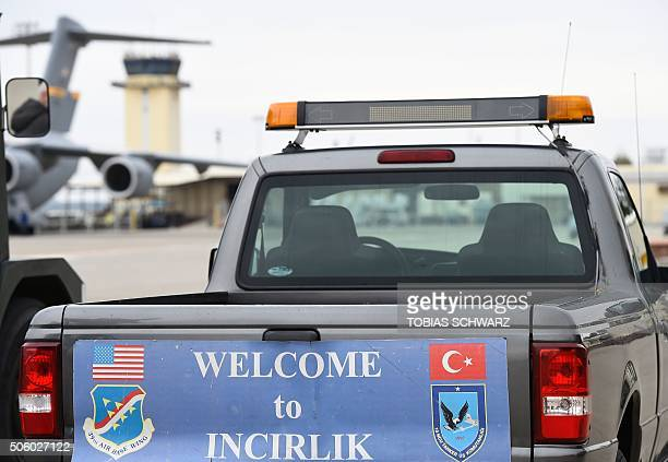 A service vehicle with a sign reading 'Welcome to Incirlik' is pictured at the air base in Incirlik Turkey on January 21 2016 / AFP / POOL / TOBIAS...