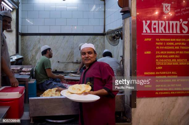 A serviceboy of Karims Hotel is collecting ROTI Jama Masjid situated in one of the most crowded area of New Delhi maintaining the aroma of...
