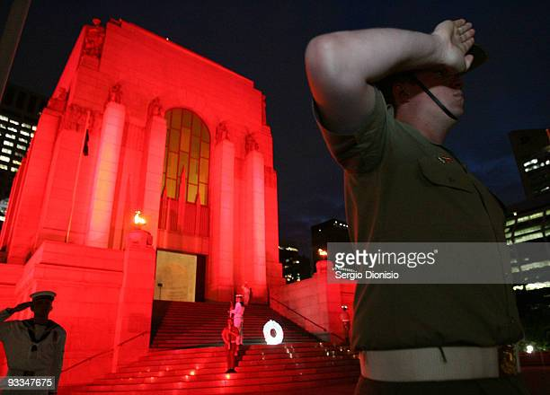 Serviceman from the Australia Federation Guard salute during a minutes silence at the ANZAC Memorial 75th Anniversary Ceremony on November 24 2009 in...