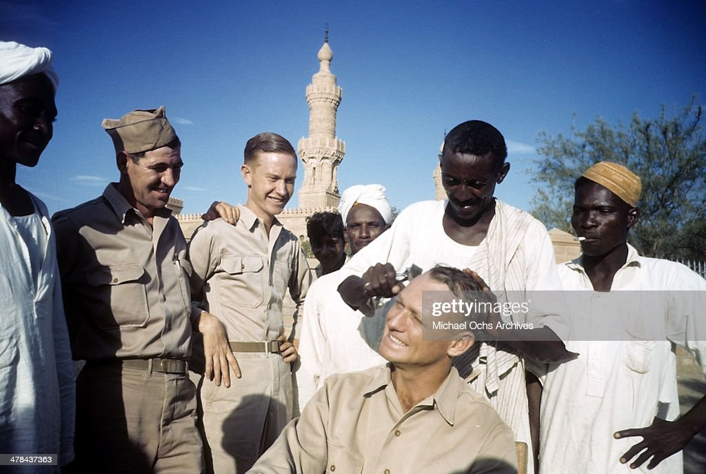 US serviceman gets a hair cut from a local barber at the US Army and Airforce base in Khartoum AngloEgyptian Sudan