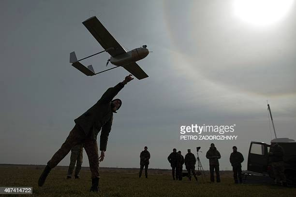 A serviceman launches an unmanned reconnaissance aircraft at the position of the Ukrainian forces near eastern Ukrainian city of Lysychansk Lugansk...