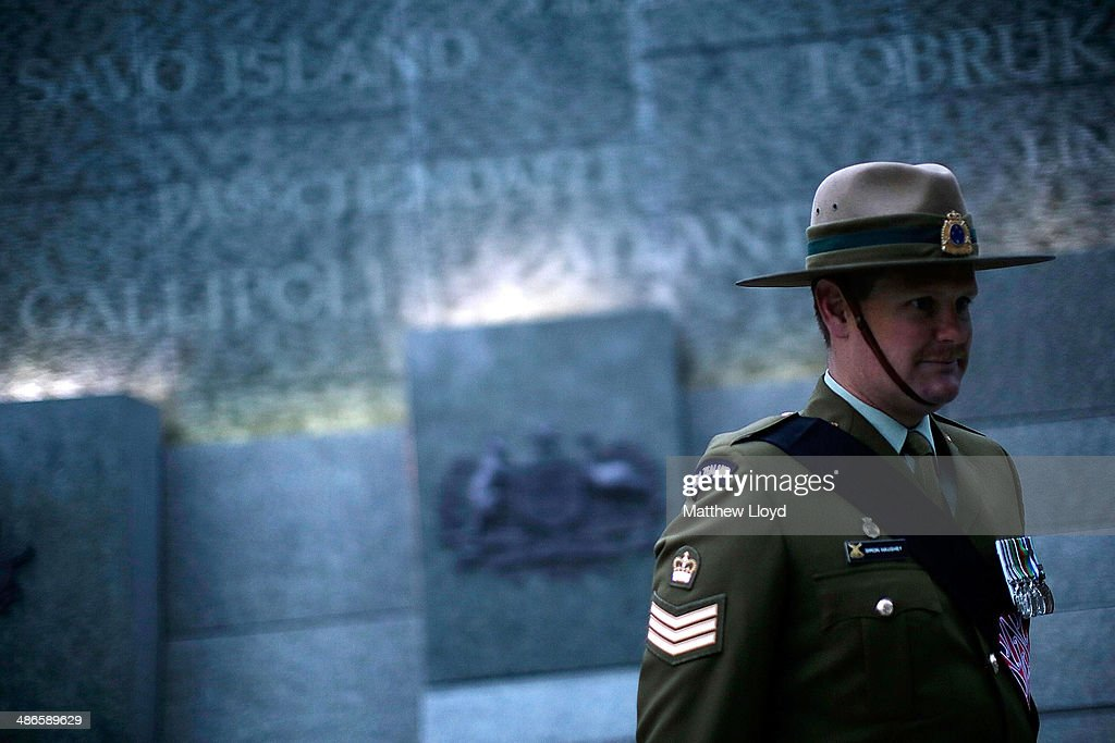 A serviceman stands in front of the Australian War Memorial during a dawn remembrance service at the Wellington Arch on ANZAC Day at Hyde Park on April 25, 2014 in London, England. It is the 99th anniversary of the Galipoli landings in which tens of thousands of servicemen died.