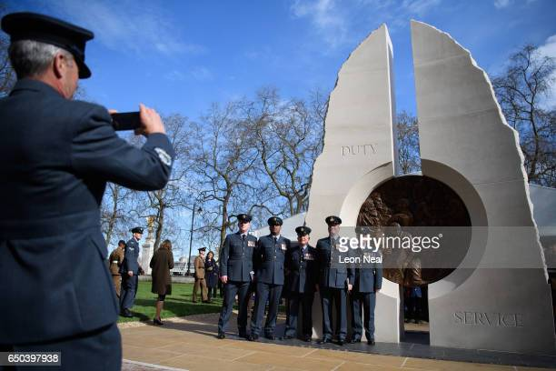 Servicemen and relatives gather around the new memorial to men and women from the UK Armed Forces and civilians who served their country in the Gulf...