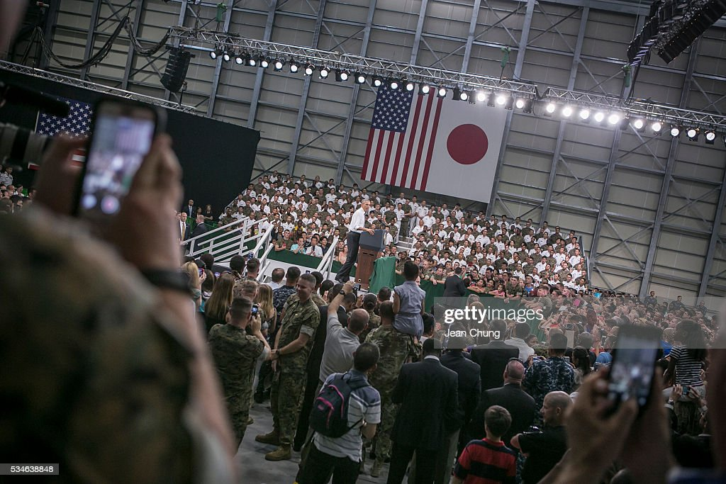 U.S. servicemen (L) and (R) take snapshots of the U.S. President Barack Obama (C) during his speech at the Marine Corps Air Station Iwakuni (MCAS Iwakuni) on May 27, 2016 in Iwakuni, Japan. President Obama flew in to the MCAS Iwakuni on Air Force One, and visited the troops before visiting Hiroshima.