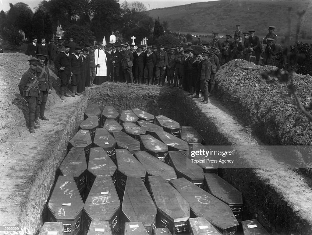 Servicemen attend the mass funeral in Cobh, County Cork of the victims of the Lusitania disaster. The Cunard liner was torpedoed by a German submarine off the coast of Ireland and sank with the loss of 1,198 lives.