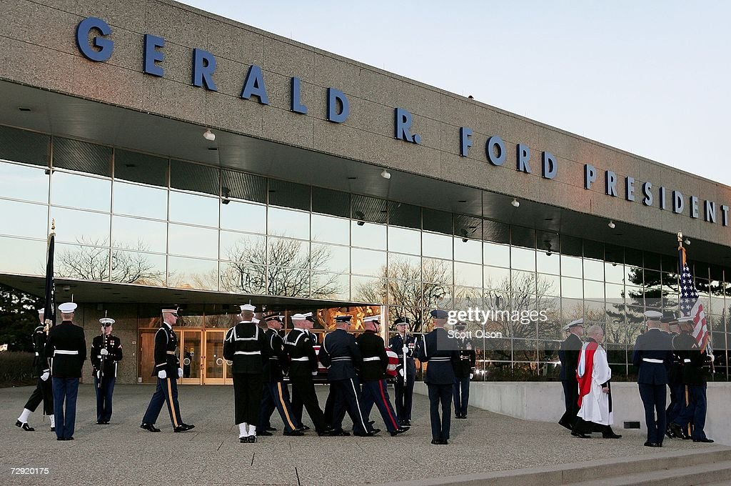 Servicemen carry the remains of former President Gerald Ford to the interment site on the grounds of the Gerald R Ford Presidential Museum January 3...