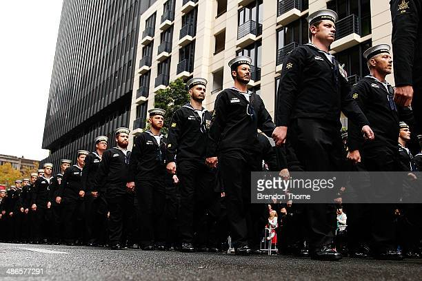 Servicemen make their way down Bathurst Street during the ANZAC Day parade on April 25 2014 in Sydney Australia Veterans dignitaries and members of...
