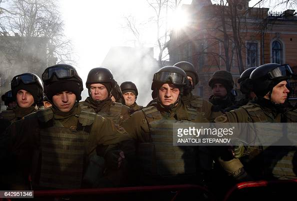 Servicemen of the Ukrainian National Guard stand during a rally against trade with the occupied territories in Kiev on February 19 2017 More than a...