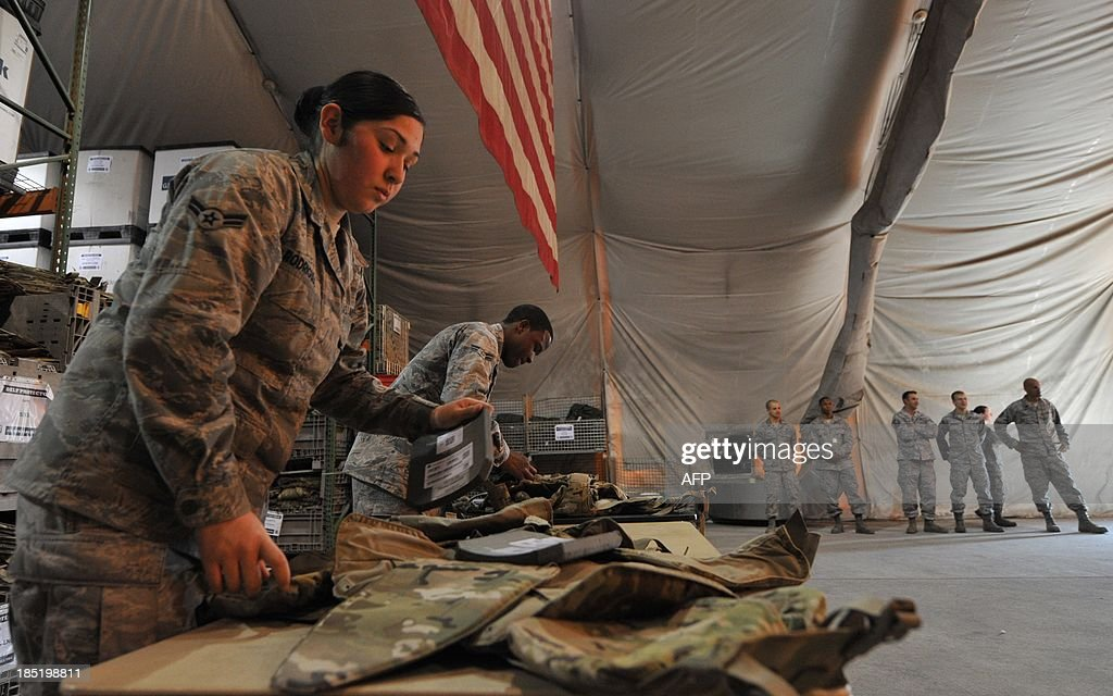 US servicemen perform a daily routine in the stock outfit at the US transit center in Manas, 30 km outside Bishkek, on October 18, 2013. International coalition forces are to exit Afghanistan by the end of next year, leaving local forces to take on fighting the Taliban alone.