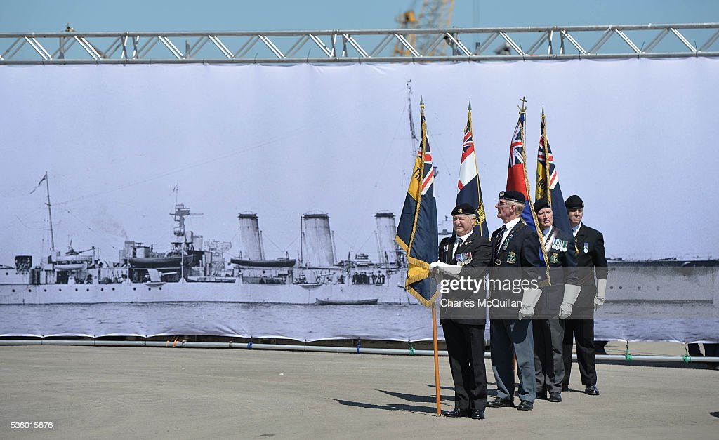 Servicemen prepare for a service at HMS Caroline in front of a banner of the ship on May 31, 2016 in Belfast, Northern Ireland. HMS Caroline is the last surviving ship from the 1916 Battle of Jutland and today hosted a special all island commemoration service ahead of it's reopening to the public tomorrow after a major restoration project. The Battle of Jutland is remembered as the largest and deadliest naval battle of World War One, where more than 6,000 British and more than 2,500 German personnel lost their lives in the 36-hour Battle off the coast of Denmark.